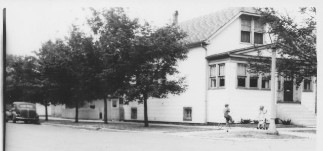 Old Black and White Photo of a House, Vintage Car and Children Playing